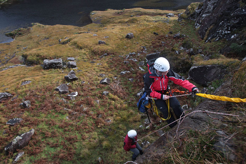 Abseiling to a casual during training.