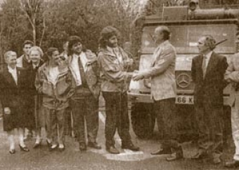Klaus Noelke, the honorary German consul in Kerry, presents the keys of the Mercedes Unimog to the Team in 1990. From left to right, Paul Walker, Maureen Chevins, Richard Stack, Maureen O'Reilly, Mary McGillycuddy, Mike Shea, Con Moriarty, Klaus Noelke, Gerry Moore, Louis O'Toole, Tim Murphy.