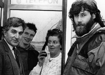 The much awaited installation of a phone box in Cronin's Yard. From left to right, Eddie Cahill (Telecom Eireann District Manager), Kevin Tarrant, Eileen Cronin, Con Moriarty.