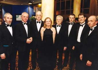 Team members Tim Long, Jimmy Laide, Tim Murphy, Marguerite Brosnan, Christy McCarthy, Larry Madden, Mike Sandover and Mike Long at the 1999 presentation of a prestigious 'Kerryman' Community Merit Award.