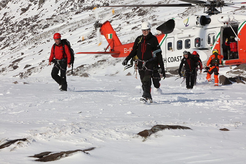 Cathal Cudden, John Dowd, Larry Madden and John Cronin disembarking from Rescue117.