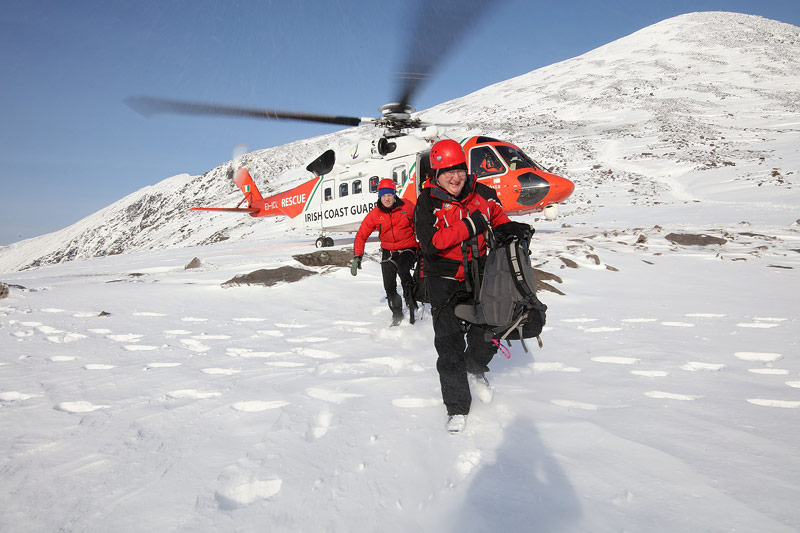 Brendan Coffey and Don Murphy disembarking from Rescue 117.
