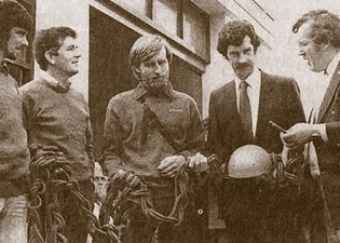 At the opening of the Rescue Station in 1983. From left to right, Team members Paddy O'Riordan, Seán O'Suilleabheán and Paul Walker, An Tánaiste Dick Spring, and Gary Farrell, chairman of the Irish Mountain Rescue Association.