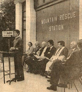 The opening of the country's first dedicated Mountain Rescue station, 1983. Sean Ó'Suilleabháin, team leader, is speaking. Seated are Tom Arthur, Canon Matt Keane, the Killorglin Parish Priest, An Tánaiste Dick Spring, Bishop Empey, and County Manager T.F. Collins.