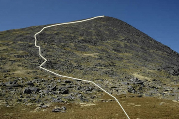 The long drawn out summit slope of Carrauntoohil as seen from the top of the Devil's Ladder. The path sub-divides many times here but all variations lead eventually to the summit.
